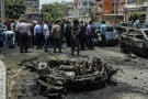 Les forces de sécurité égyptiennes sur le site de l'attentat qui a coûté la vie au procureur général, Hicham Barakat, le 29 juin 2015.