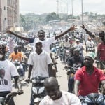 Des supporters d'Alassane Ouattara, à Abidjan,  le 15 octobre 2015