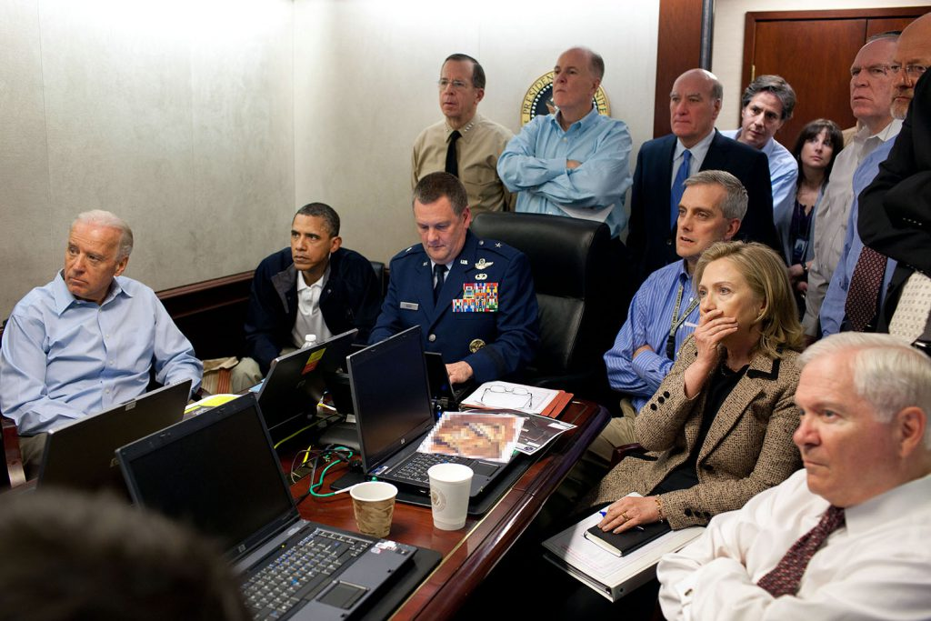 "May 1, 2011 ""Much has been made of this photograph that shows the President and Vice President and the national security team monitoring in real time the mission against Osama bin Laden. Some more background on the photograph: The White House Situation Room is actually comprised of several different conference rooms. The majority of the time, the President convenes meetings in the large conference room with assigned seats. But to monitor this mission, the group moved into the much smaller conference room. The President chose to sit next to Brigadier General Marshall B. ""Brad"" Webb, Assistant Commanding General of Joint Special Operations Command, who was point man for the communications taking place. WIth so few chairs, others just stood at the back of the room. I was jammed into a corner of the room with no room to move. During the mission itself, I made approximately 100 photographs, almost all from this cramped spot in the corner. There were several other meetings throughout the day, and we've put together a composite of several photographs (see next photo in this set) to give people a better sense of what the day was like. Seated in this picture from left to right: Vice President Biden, the President, Brig. Gen. Webb, Deputy National Security Advisor Denis McDonough, Secretary of State Hillary Rodham Clinton, and then Secretary of Defense Robert Gates. Standing, from left, are: Admiral Mike Mullen, then Chairman of the Joint Chiefs of Staff; National Security Advisor Tom Donilon; Chief of Staff Bill Daley; Tony Blinken, National Security Advisor to the Vice President; Audrey Tomason Director for Counterterrorism; John Brennan, Assistant to the President for Homeland Security and Counterterrorism; and Director of National Intelligence James Clapper. Please note: a classified document seen in front of Sec. Clinton has been obscured."" (Official White House Photo by Pete Souza) This official White House photograph is being made available only for publication"