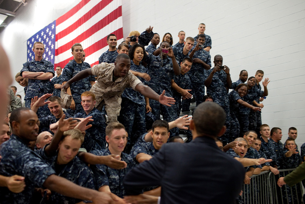 President Barack Obama greets members of the audience following his remarks at an event with military personnel at the Pensacola Naval Air Station in Pensacola, Fla., June 15, 2010. This was the President's fourth trip to the Gulf Coast to assess the ongoing response to the BP oil spill in the Gulf of Mexico.(Official White House Photo by Pete Souza) This official White House photograph is being made available only for publication by news organizations and/or for personal use printing by the subject(s) of the photograph. The photograph may not be manipulated in any way and may not be used in commercial or political materials, advertisements, emails, products, promotions that in any way suggests approval or endorsement of the President, the First Family, or the White House.
