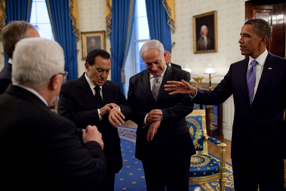 Prior to the start of their working dinner with President Barack Obama, President Mahmoud Abbas of the Palestinian Authority, President Hosni Mubarak of Egypt, and Prime Minister Benjamin Netanyahu of Israel, check their watches to see if it is officially sunset, in the Blue Room of the White House, Sept. 1, 2010. (Official White House Photo by Pete Souza) This official White House photograph is being made available only for publication by news organizations and/or for personal use printing by the subject(s) of the photograph. The photograph may not be manipulated in any way and may not be used in commercial or political materials, advertisements, emails, products, promotions that in any way suggests approval or endorsement of the President, the First Family, or the White House.