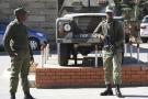 Des militaires stationnent devant le quartier général de l'armée à Maseru, lors d'une tentative de coup d'État au Lesotho en août 2014.