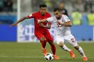 Naïm Sliti face au joueur anglais Jesse Lingard lors du premier match de la Tunisie au Mondial 2018, le 18 juin.