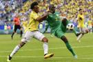 Le Sénégalais Kalidou Koulibaly (à droite), face au Colombien Juan Cuadrado, lors de la Coupe du monde de football 2018.