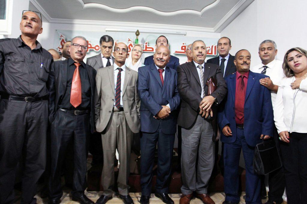Les responsables des quinzepetites formations qui défendent la candidature du président sortant, le 15août, à Alger.