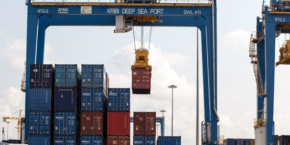 A gantry crane lifts a shipping container dockside at the container terminal, operated by a consortium of China Harbour Engineering Co. (CHEC), Bollore SA, and CMA CGM S.A, at the Port of Kribi, Cameroon, on Wednesday, Aug. 1, 2018. Since the initial agreement to build the port at Kribi was signed in 2009, 10 Chinese firms, including CHEC and its holding company, China Communications Construction Co., have obtained concessions to mine bauxite, iron ore and other minerals. Photographer: Adrienne Surprenant/Bloomberg via Getty Images