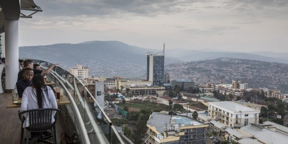 Downtown Kigali seen from the roof of the Ubumwe hotel. Outside of the Rwanda's capital Kigali, delivery of emergency blood supplies to rural clinics and hospitals has been extremely challenging due to the rugged landscape and unpaved roads. Zipline has partnered with the Rwandan government  to provide delivery of blood and medical supplies by drone  Restauration, panorama Africa East Africa Rwanda UAV Ubumwe hotel Zipline blood delivery downtown drone highrise modern urban african blood supply rwandan medical health