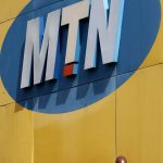 A man looks at his mobile at the end of a strike of MTN workers outside the company's headquarters in Johannesburg May 20, 2015. About 2,000 workers at MTN Group went on strike on Wednesday demanding higher pay, union leaders said, threatening a prolonged walkout at South Africa's second-biggest telecoms firm by subscribers. Zodwa Kubeka, spokeswoman for the Communication Workers Union (CWU), said its members at MTN want a 10 percent pay rise and higher allowances for work done over weekends and holidays. REUTERS/Siphiwe Sibeko – GF10000101389