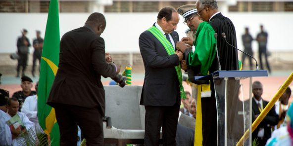 E5JWBN Nouakchott, Mauritania. 2nd Aug, 2014. president ABDEL AZIZ receives a ribbon and the medal during the presidential inauguration ceremony in the Olympic stadium in Nouakchott.Abdel Aziz was sworn in as a president of Mauritania after the landslide victory during the elections held in June 2014. The ceremony was attended by thousands of people, several heads of states, diplomatic core of various countries so as the representatives of United Nation. Credit	:  ZUMA Press, Inc./Alamy Live News
