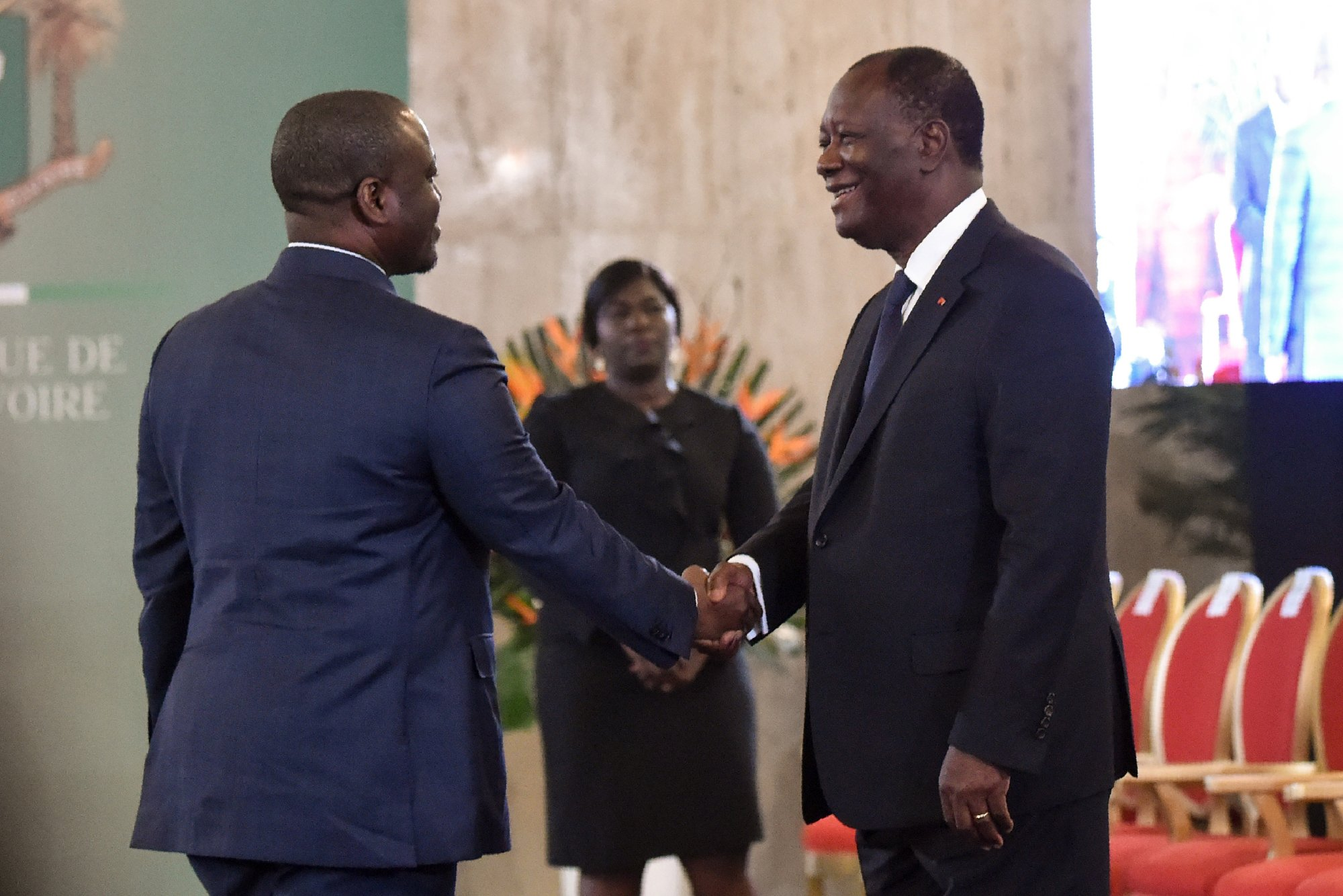 Ivory Coast's President Alassane Ouattara (R) shakes hands with Ivory Coast's National Assembly President Guillaume Soro (L) during a New Year wishes ceremony at the presidential palace in Abidjan on January 4, 2018. (Photo by SIA KAMBOU / AFP)