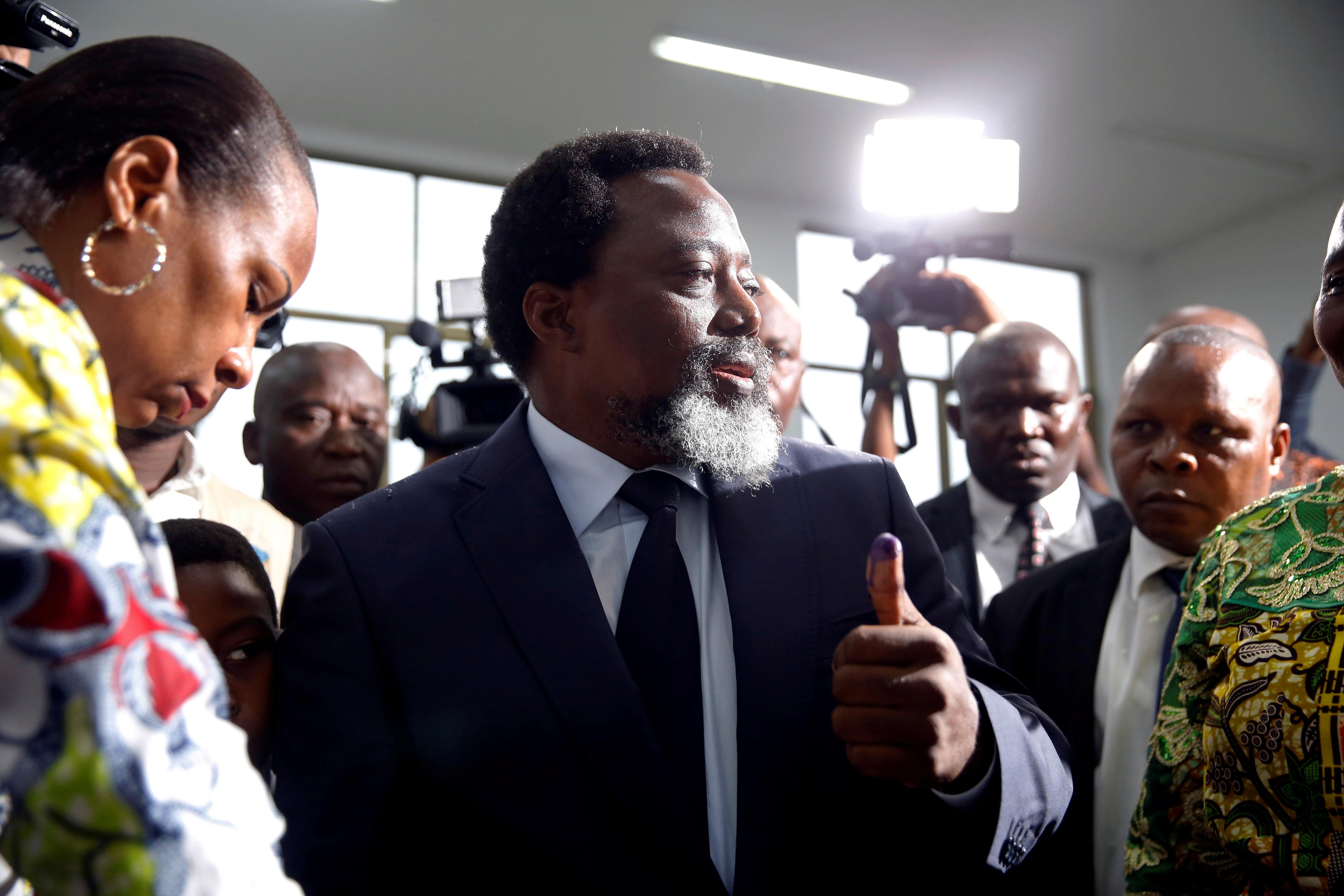 Joseph Kabila, lors du scrutin présidentiel du 30 décembre 2018 en RDC, dans un bureau de vote de Kinshasa.