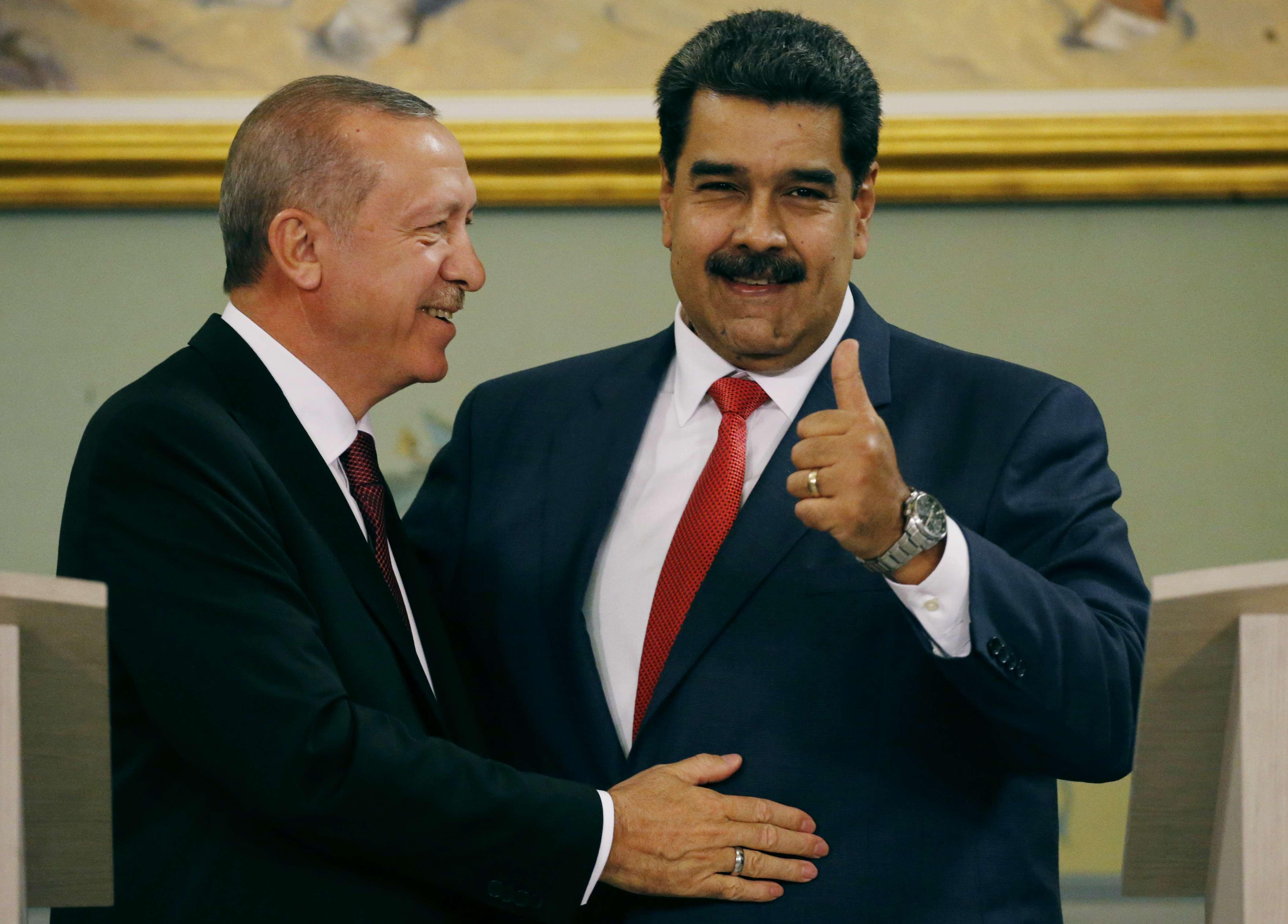 Recep Tayyip Erdogan et Nicolàs Maduro lors d'une conférence de presse commune au palais présidentiel de Miraflores à Caracas, le 3 décembre 2018.
