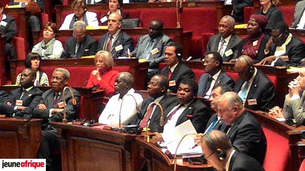 Guillaume Soro et Chérif Sy à l'Assemblée nationale française, le 5 décembre 2015.