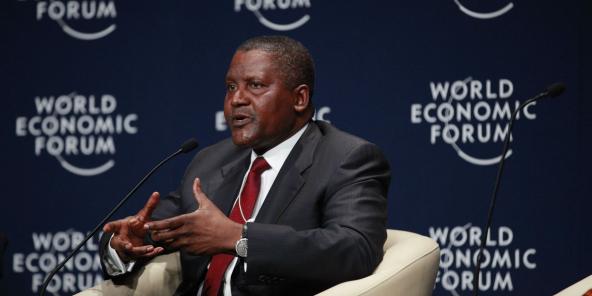 Aliko Dangote, lors d'une rencontre du Forum économique mondial en 2014 à Abuja.  - sipa ap21564436 000012 592x296 1585669609 - Nigeria – Dangote tout-puissant : héros de toute l'Afrique et homme d'affaires impitoyable