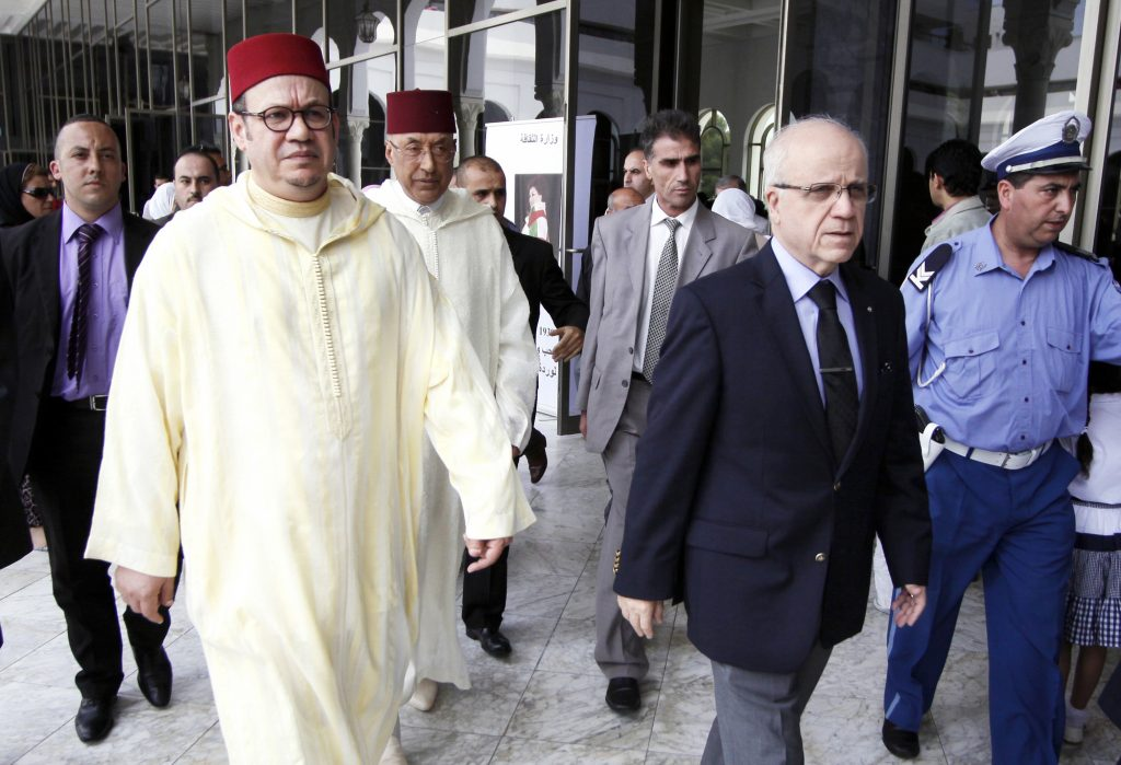 Advisor of Moroccan King Mohammed VI, Fouad el Himma (L), and Algerian minister of Foreign Affairs, Mourad Medelci (R), arrive to pay respect to late Algerian singer Warda Al-Jazairia, one of the most famous singers in the Arab world, on May 19, 2012, in Algiers. Algerian singer Warda, whose powerful vocal range and patriotic songs earned her legendary status throughout the Arab world, died of a heart attack in Cairo late on May 17, at the age of 72, her family said.  AFP PHOTO / (Photo by STR / AFP)
