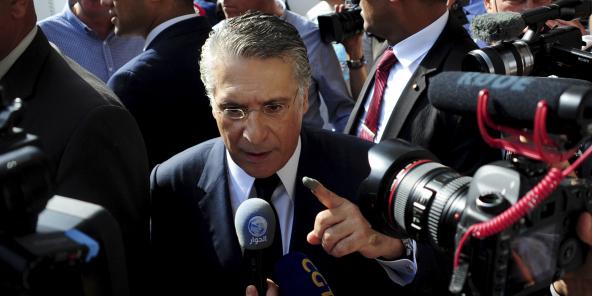 Nabil Karoui répondant aux médias après avoir voté au second tour de l'élection présidentielle, dimanche 13 octobre 2019 à Tunis.