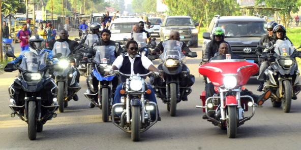 L'ancien président congolais Joseph Kabila, lors d'une parade en mot avec des membres du clubs des Motards de Kinshasa, le 1er décembre 2019.