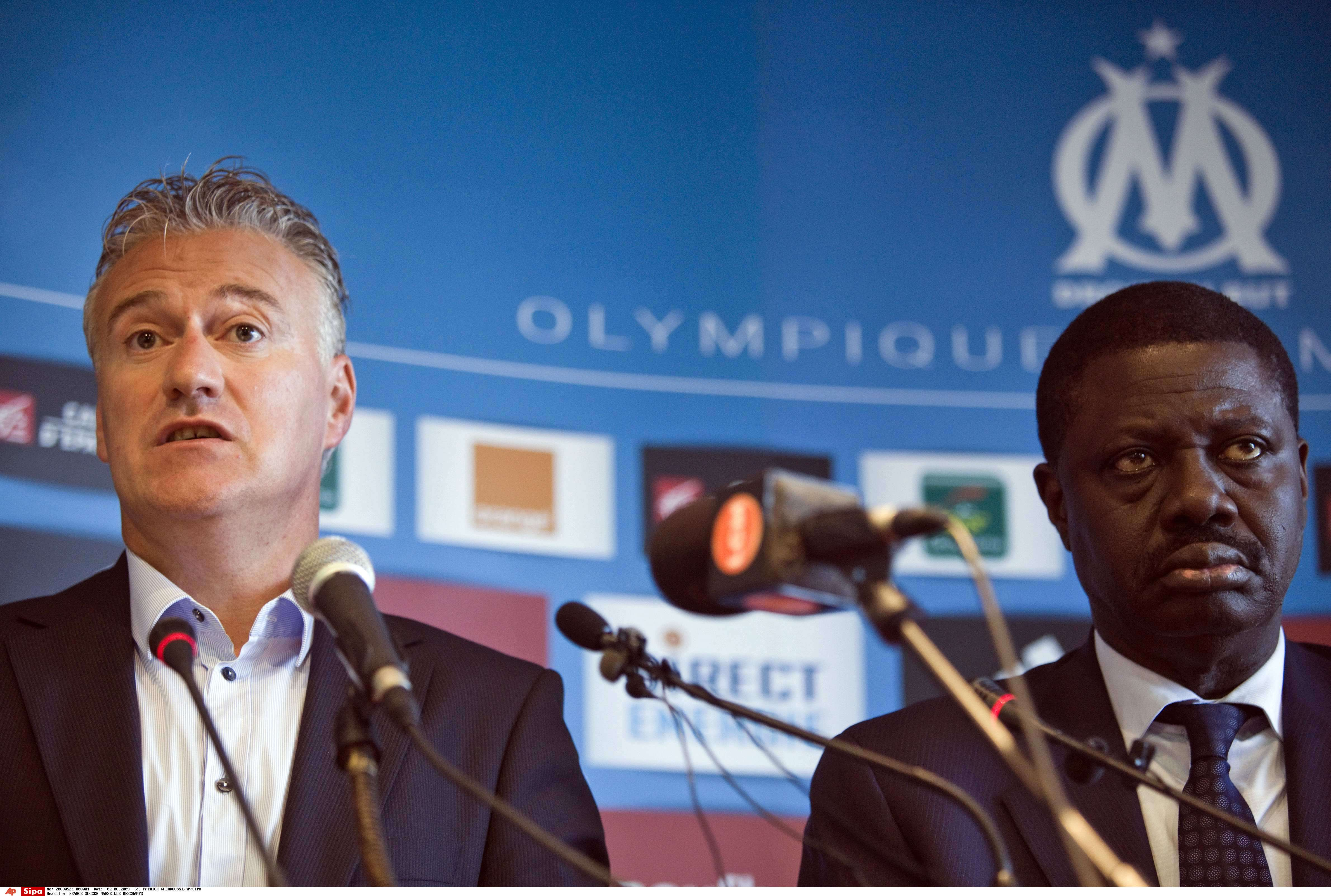 Didier Deschamps et Pape Diouf, en 2009.