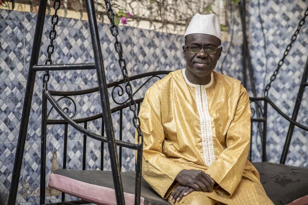 Moubarack Lo, directeur général du Bureau de Prospective Economique pose chez lui à Dakar, le 15 avril 2020.
