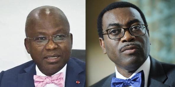 Moussa Dosso (g.), ex-administrateur ivoirien de la BAD, s'était inquiété de la gestion des ressources humaines de la banque panafricaine dirigée par Akinwumi Adesina (dr).