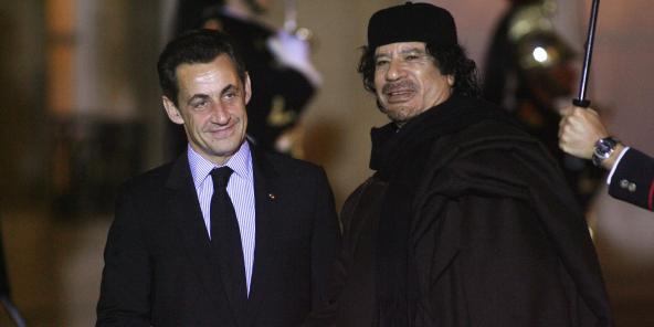 Nicolas Sarkozy et Mouammar Kadhafi, en décembre 2017 à Paris.