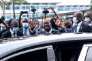 Le chef de l'État ivoirien Alassane Ouattara sortant du bureau de vote, à l'école Sainte-Marie, dans la commune de Cocody (Abidjan), le 31octobre.