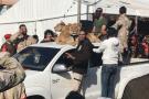 Les frères Kani et leurs lions, en Libye.