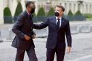 Le président rwandais Paul Kagame reçu au sommet de Paris par son homologue français Emmanuel Macron, le 18 mai 2021.