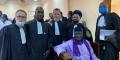 Amadou Vamoulké avec ses avocats.