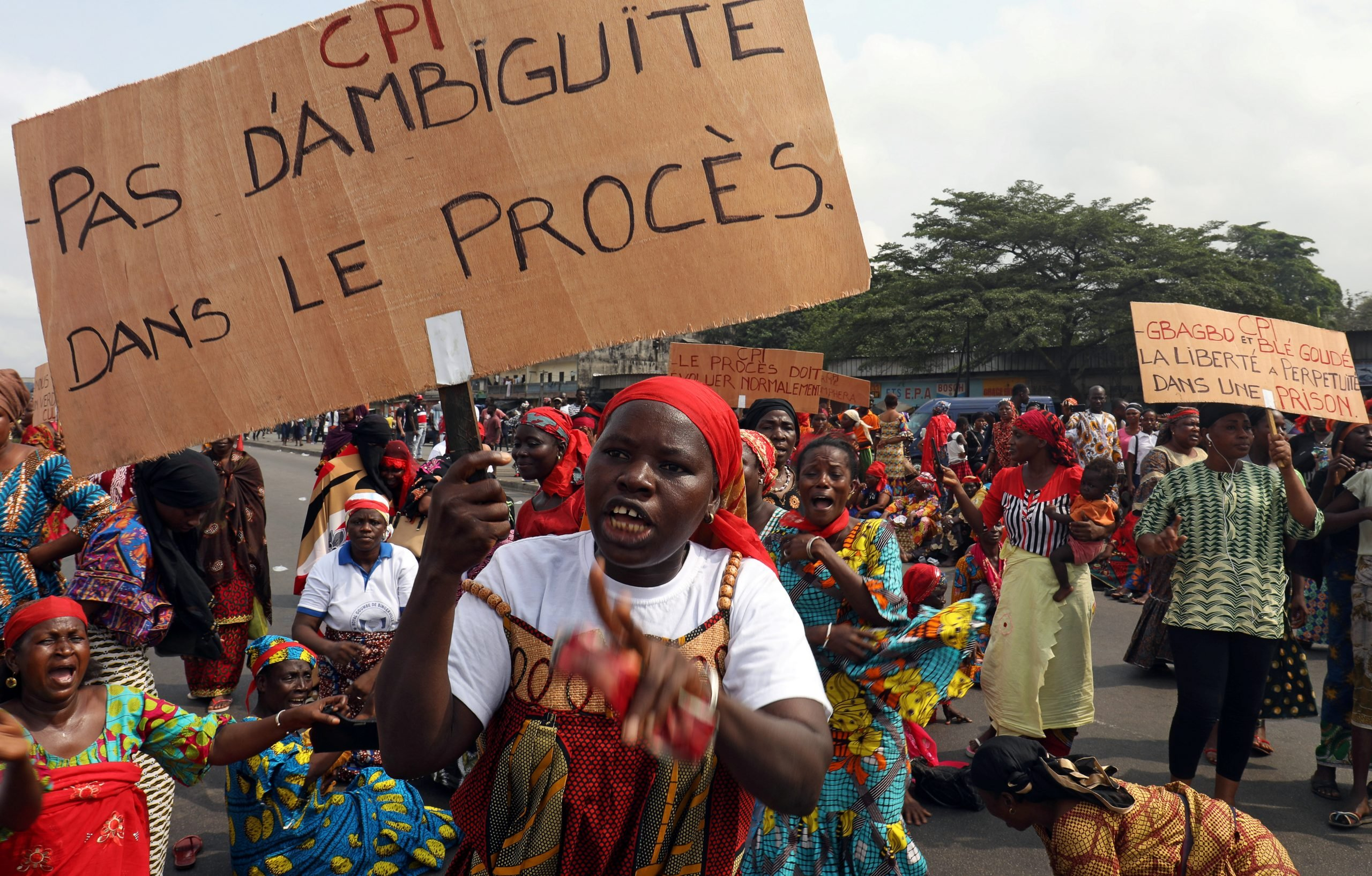 Relatives and victims of violence under former Ivorian President Laurent Gbagbo take part in a protest against his release in Abidjan's Abobo neighborhood