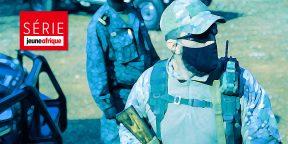 Un mercenaire russe et un membre de la garde présidentielle de Faustin Archange Touadéra, en décembre 2020 à Bangui.