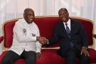 Alassane Ouattara et son prédécesseur, Laurent Gbagbo, au palais présidentiel d'Abidjan, le 27 juillet 2021.